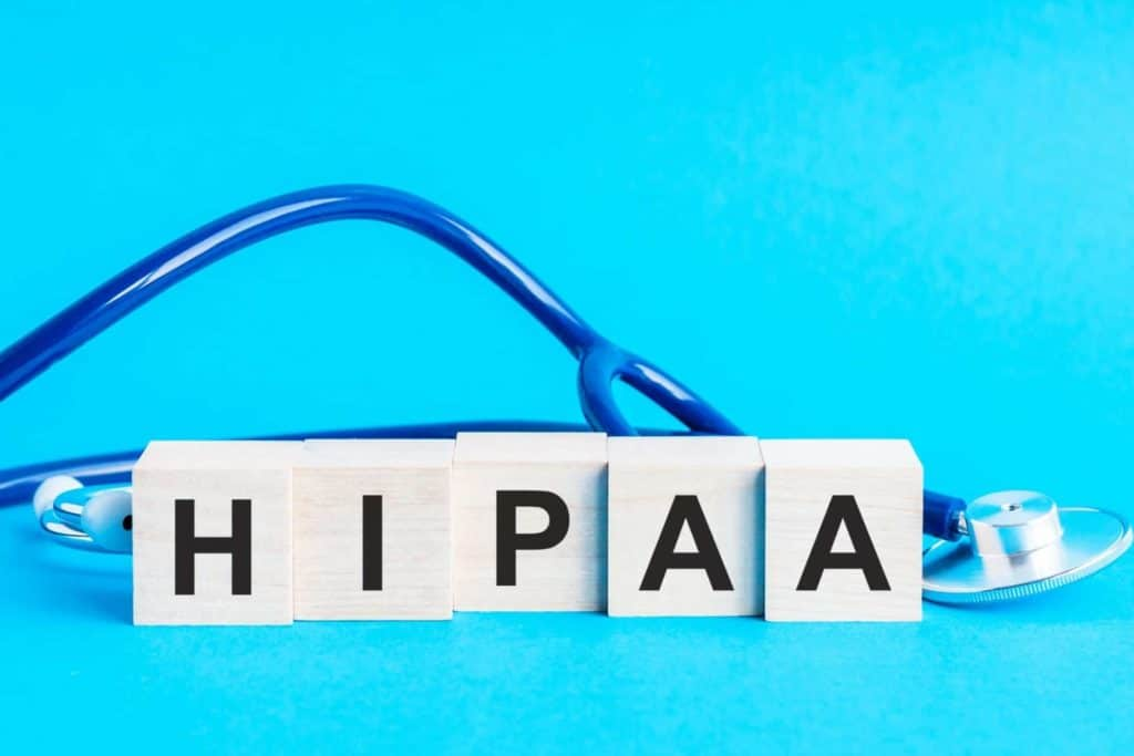Blocks spelling out HIPAA surrounded by a stethoscope.