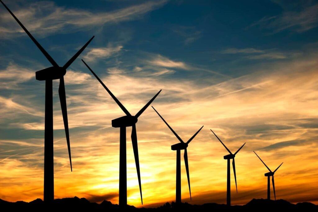 Wind turbine farm at sunset.