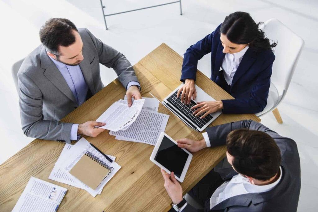 Business meeting about a HITRUST Interim assessment