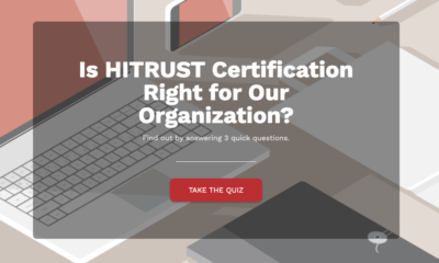 First page of a quiz about HITRUST certification on a background of computer equipment.