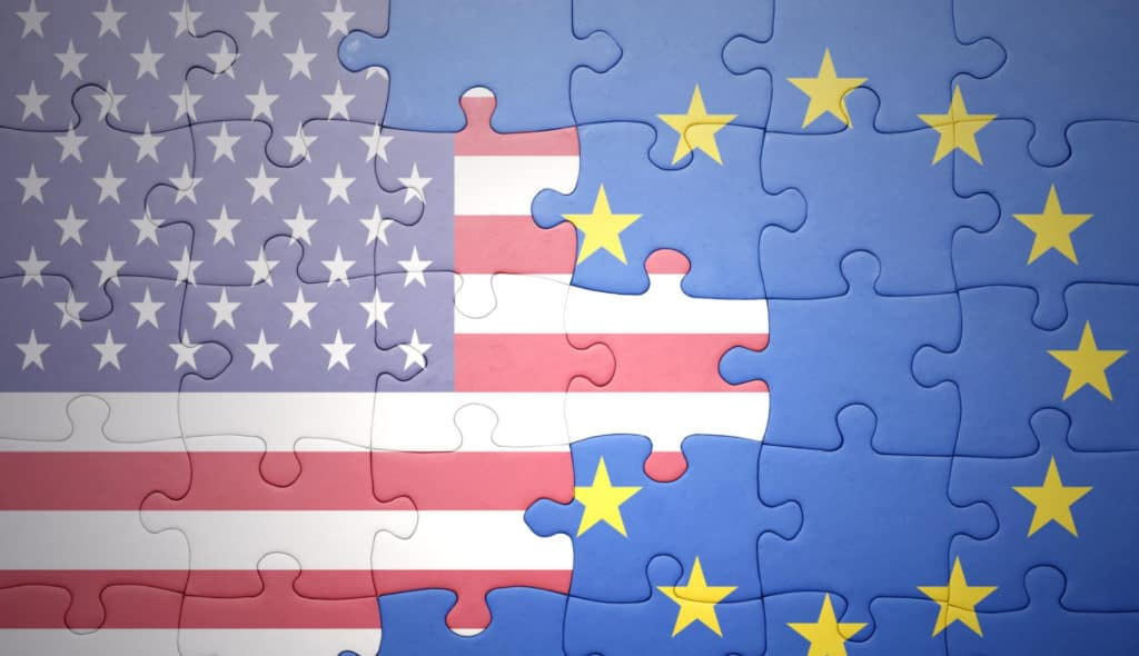United States and European flags are joined in a puzzle.