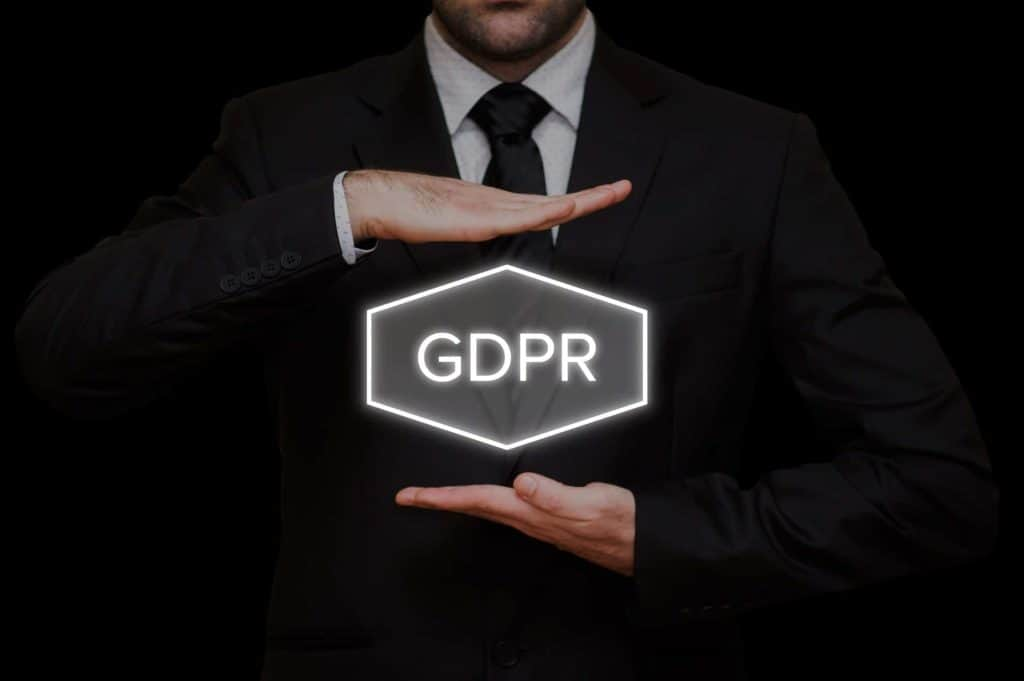 business man holds a sign with GDPR written on it